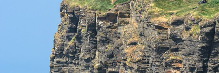 Travelers on the edge of Cliffs Of Moher