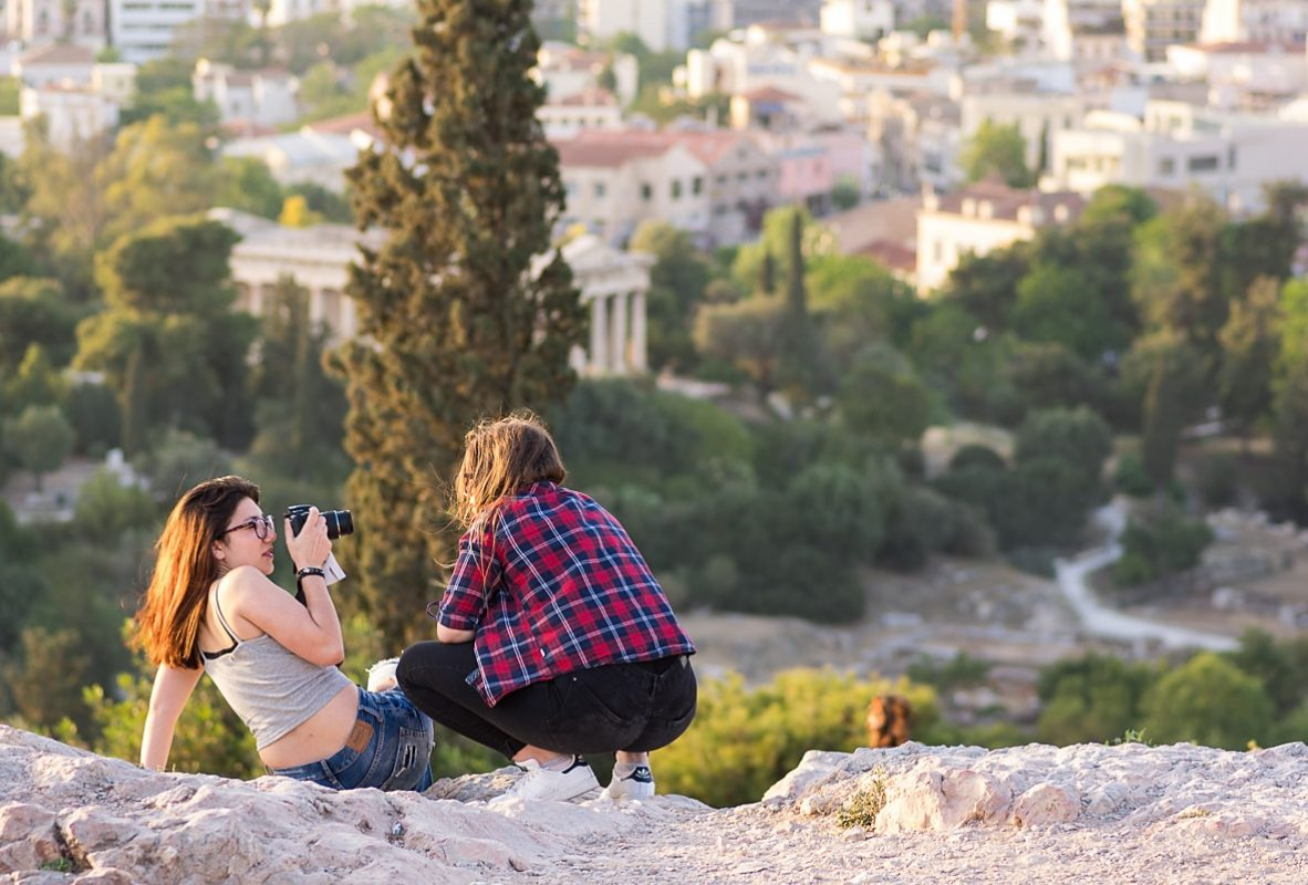 People on Areopagus Hill waiting for the sunset
