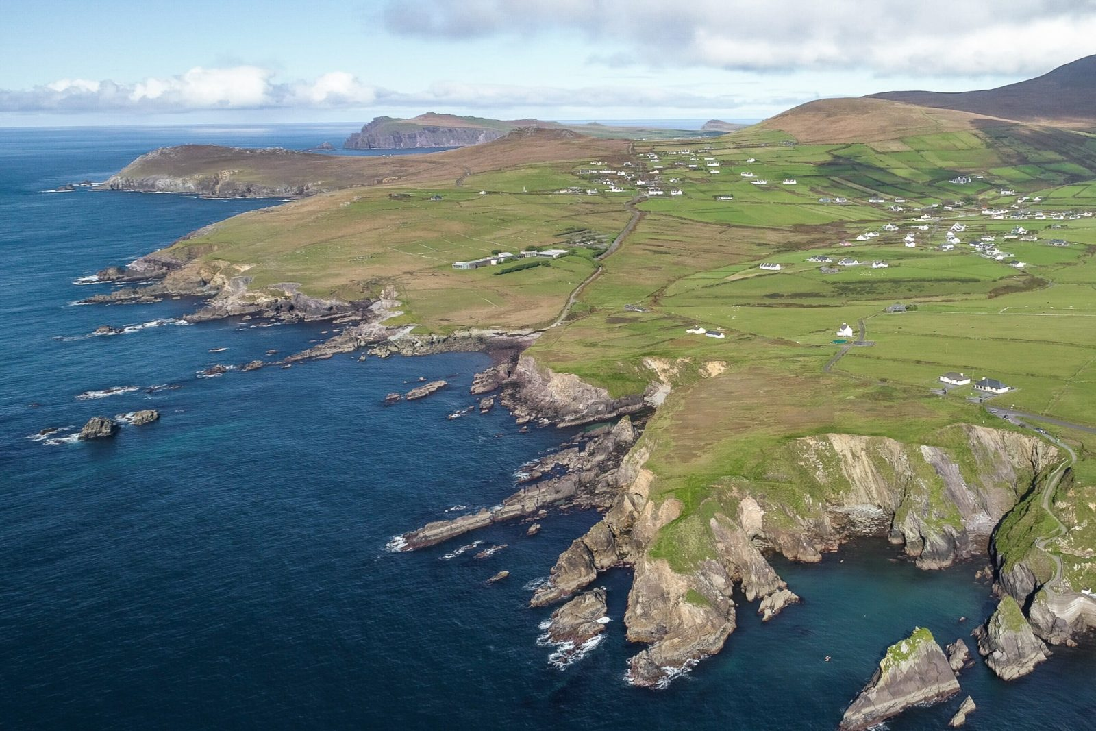 aerial shot of dunquin and the atlantic ocean