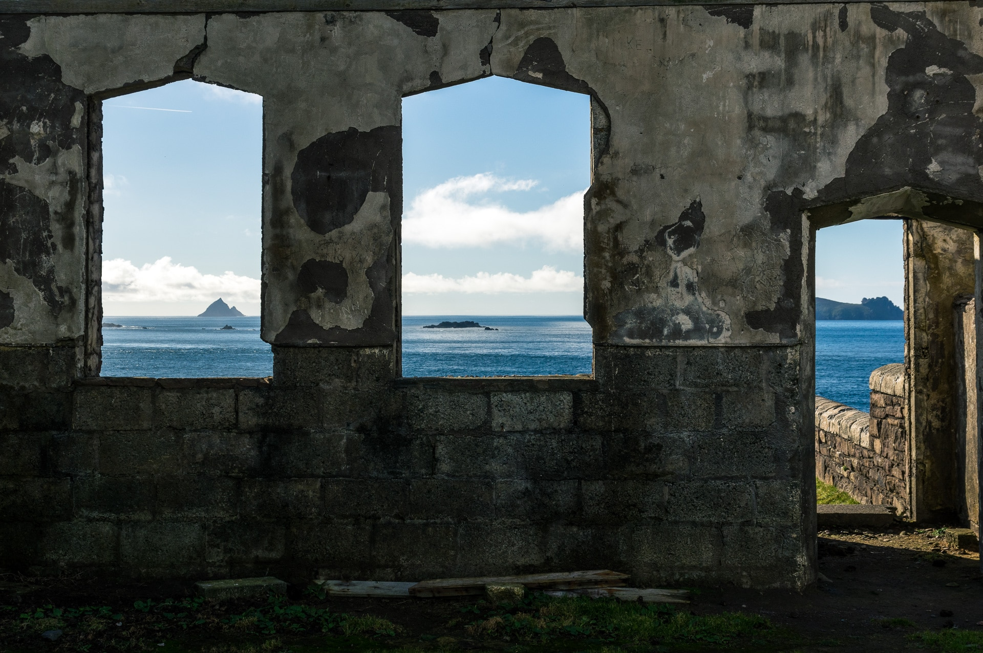 old abandoned school house and the atlantic ocean through the windows