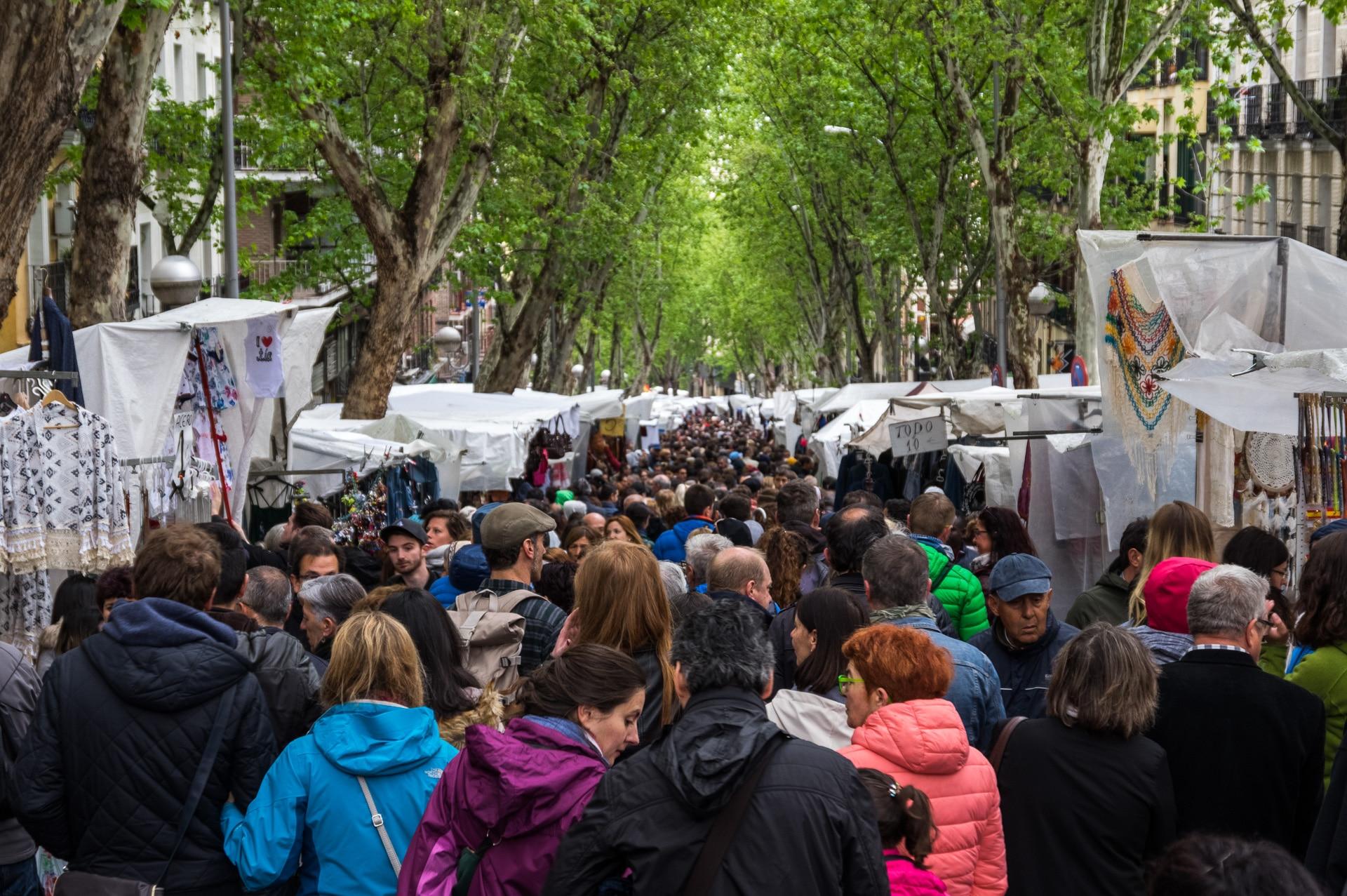 People walking on El Rastro's main street