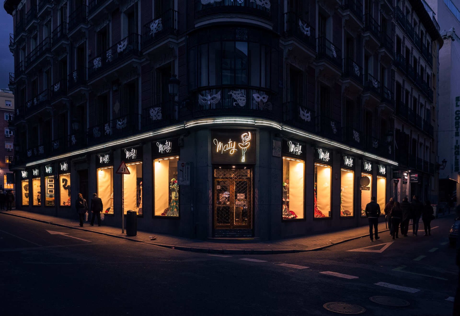 lighted shop on a dark street