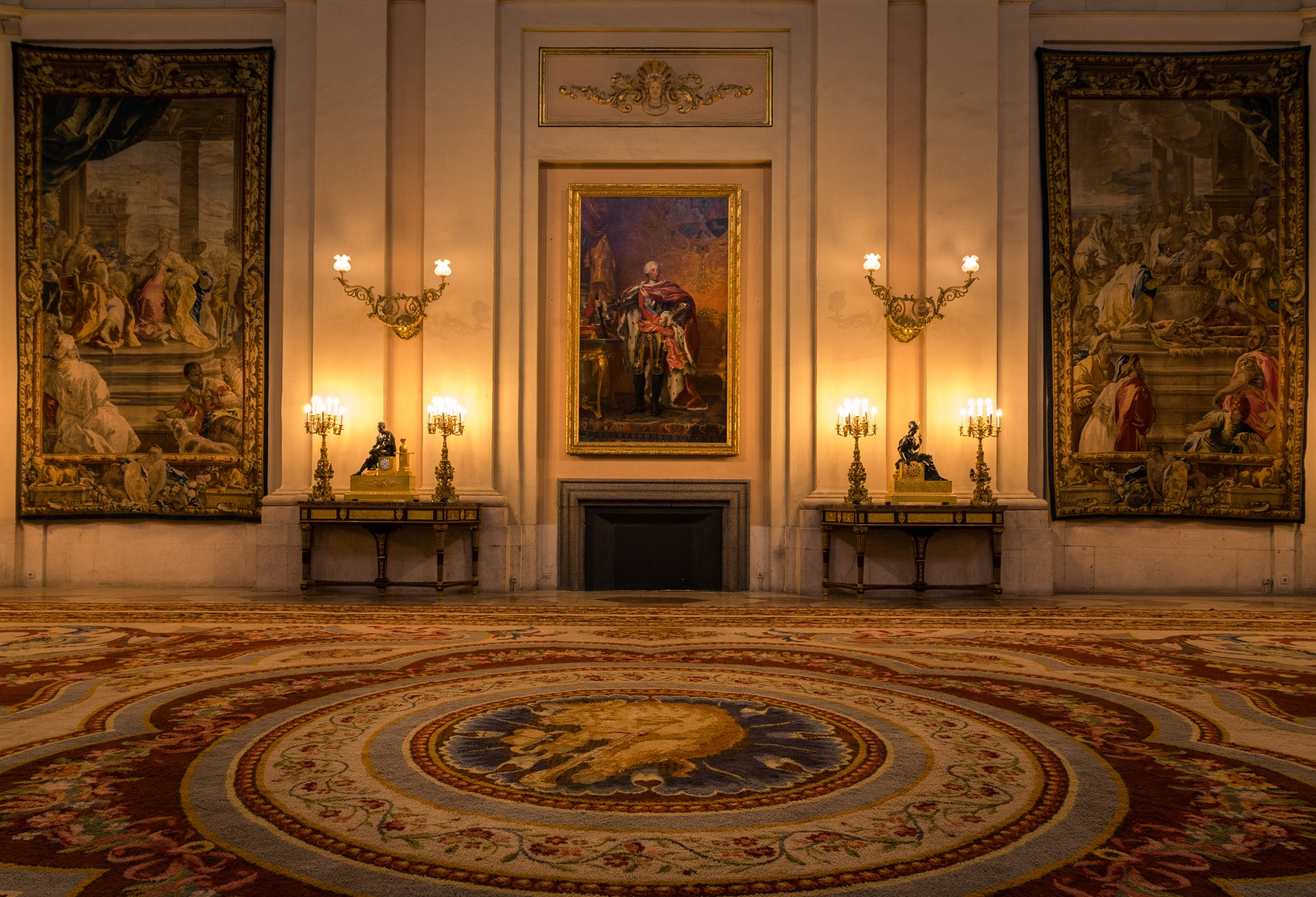 A room in royal palace with candles and a portrait