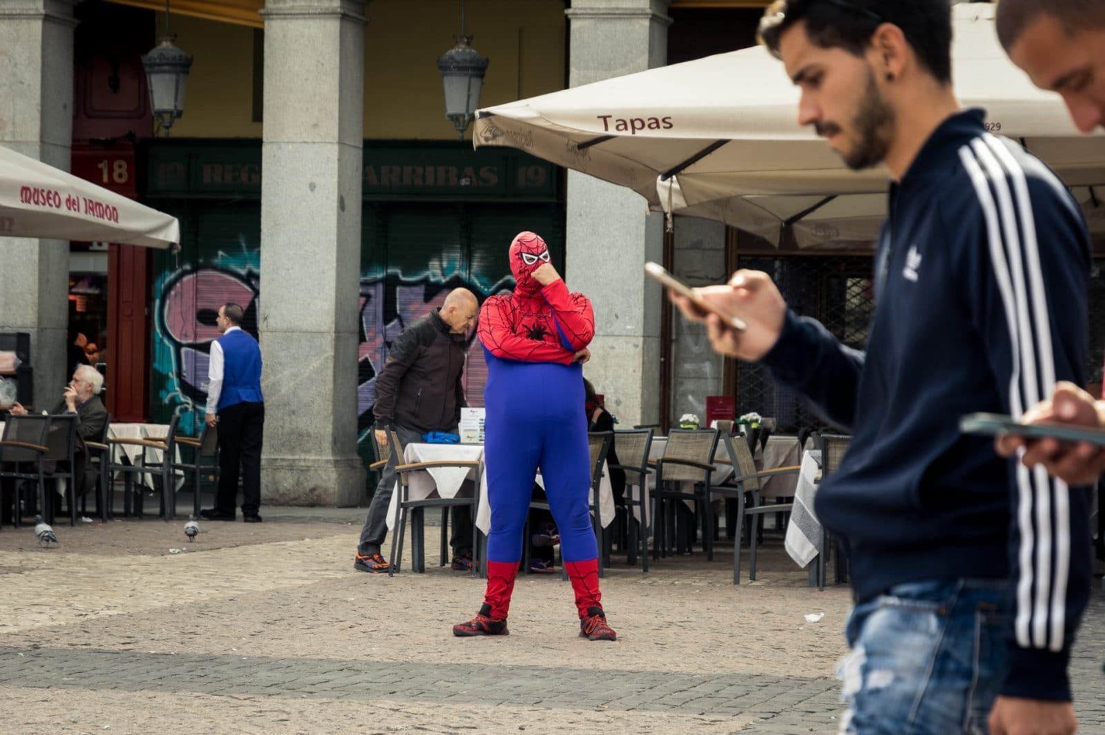 Los Madrileños a fat guy dressed as spiderman