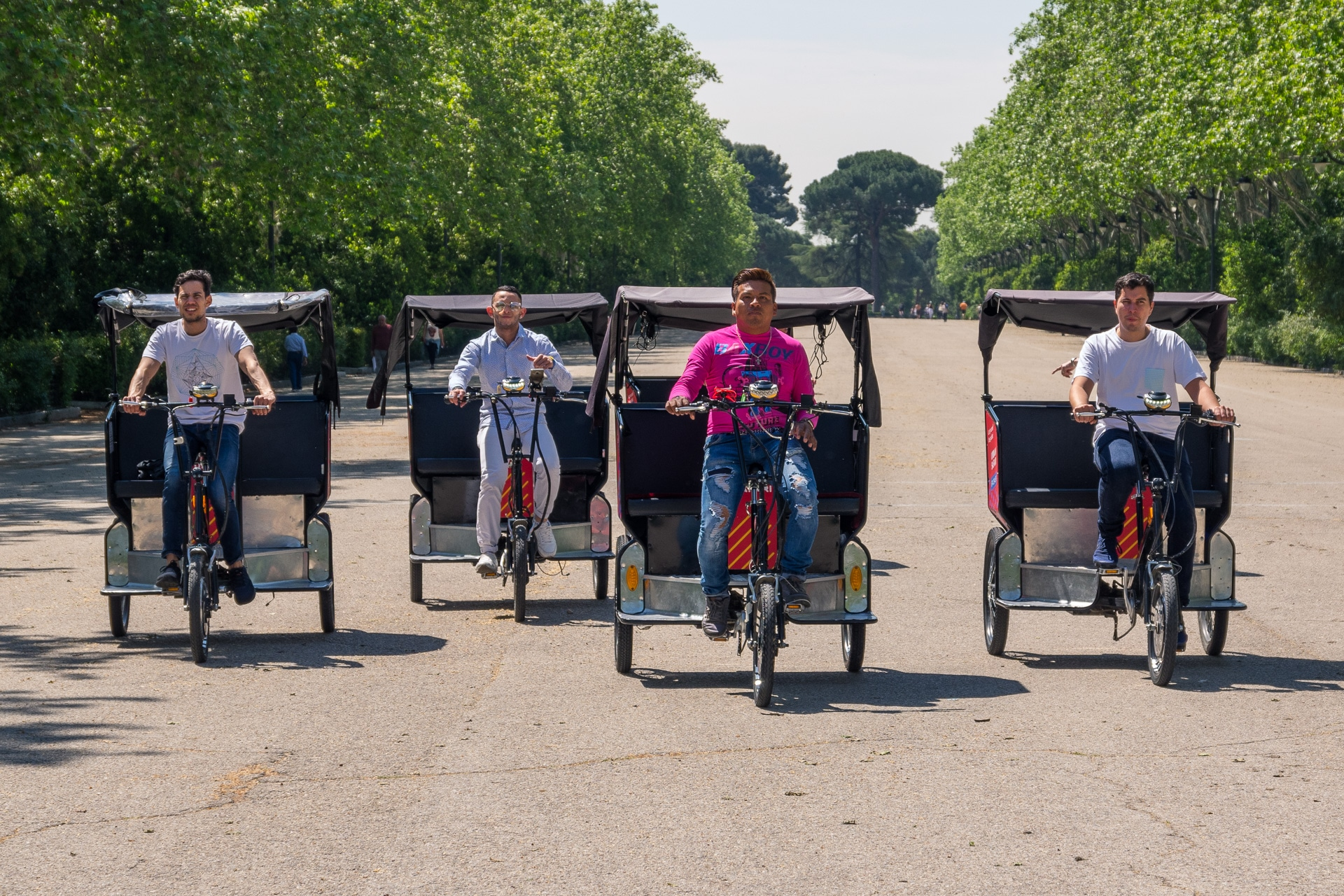 four tricycles coming head on