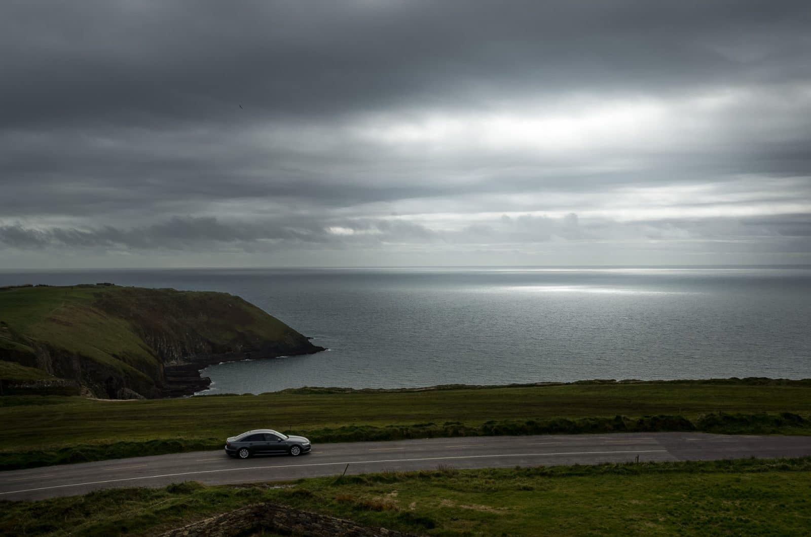 a car driving on coastal road in Cork Country near Old head of kinsale